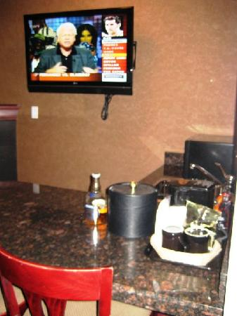 Holiday Inn Express Hotel & Suites Calgary South: Bar, Mounted TV (2 in room), fireplace, sink, fridge & microwave