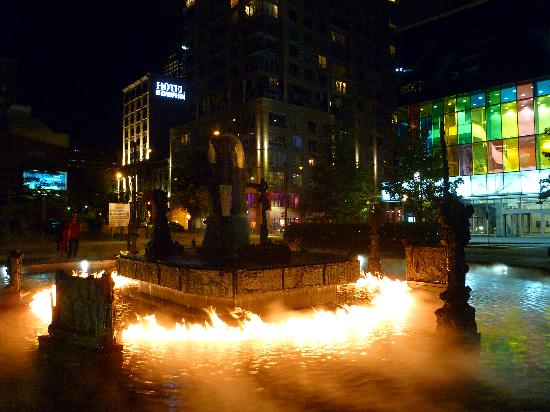 "Hotel Dauphin Montreal Downtown: ""burning fountain"" at night"