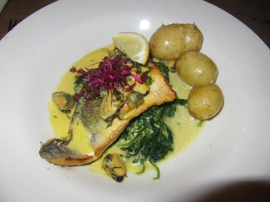 The Coach House at the England's Gate Inn: Sea Bass served on Wilted Spinach
