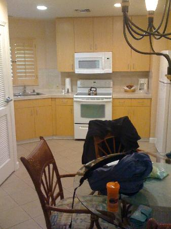 Kitchen, dining area with laundry to left