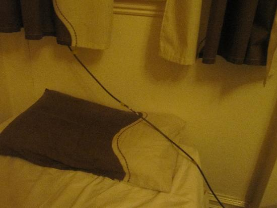 R&R Motel: TV aerial trailing across the pillow where a child is meant to sleep
