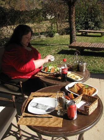Lares de Chacras: Having a snack just outside in the garden