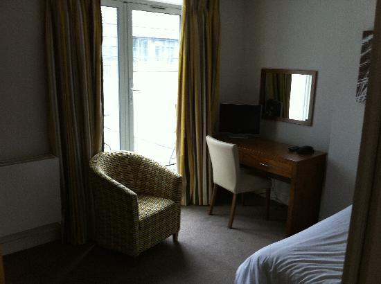 SACO Holborn - Lamb's Conduit St : Master bedroom: seating/desk/balcony access