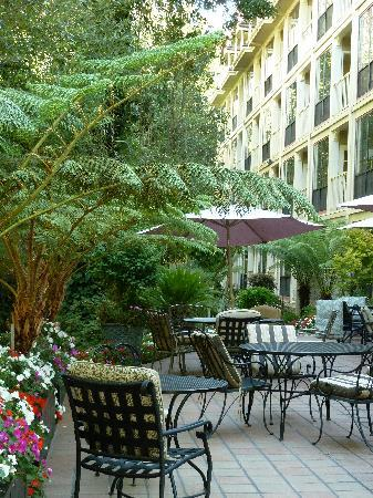 The Inn at Saratoga: Patio area by the creek and park