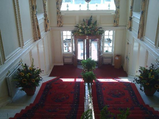 Peebles, UK: Entrance staircase and fresh flowers