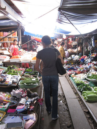 Wandee Tours: Maeklong Railway Market - The trader's wares are literally next to the tracks