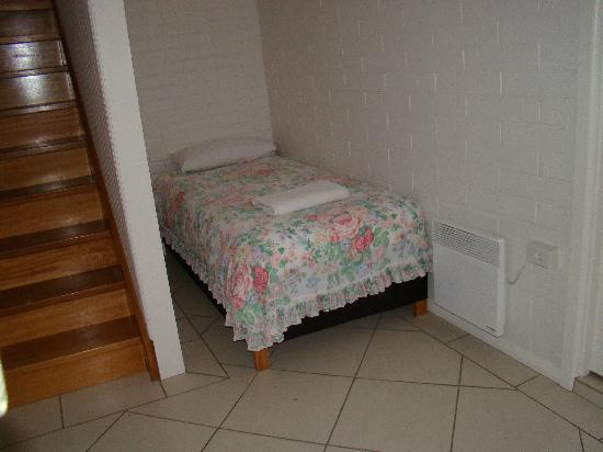 SeaCalm: Single Bed Crammed next to stairs (in basement, no less!)