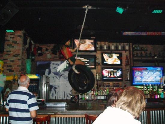 Rockhouse Bar & Nightclub : Barmaid swinging on tyre