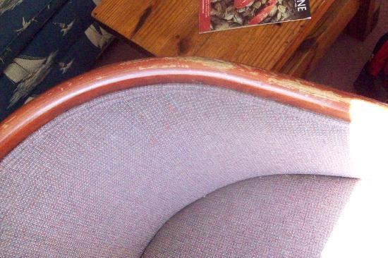 The Grand Beach Inn: stained chair