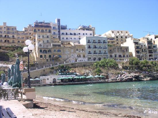 Hotel Xlendi Resort & Spa: The tall building is Hotel,  lift takes you straight to waters edge takes you under the road .