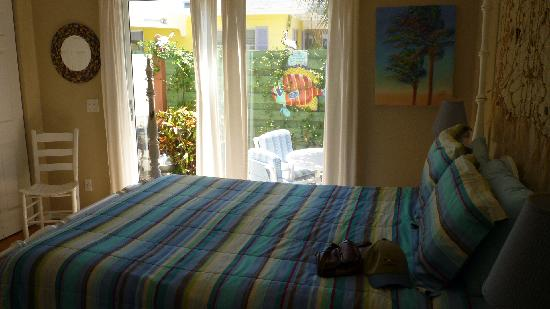 Anna Maria Beach Cottages: Master bedroom with private patio #107
