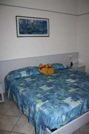 Hotel Acquamarina : The 80's flashback bed spread with my son's Pooh Bears. Haha