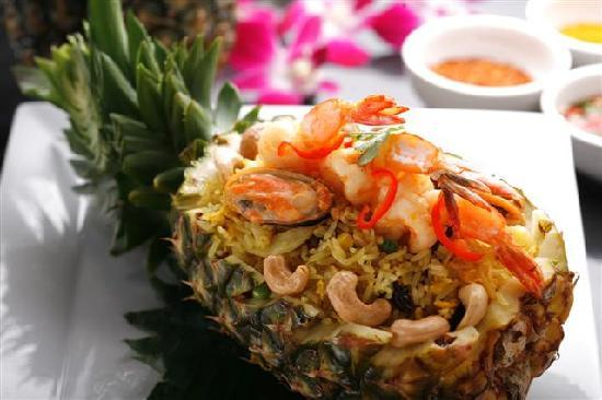 Ayuthaiya: Fried rice pineapple with seafood & chicken served in a pineapple bowl