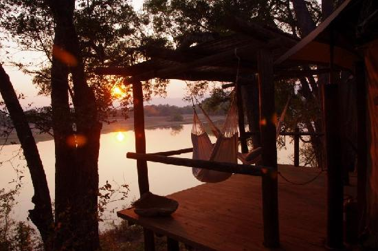 Chindeni Bushcamp - The Bushcamp Company: sunrise on our balcony