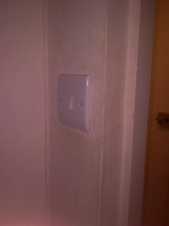 Shalimar Hotel: grubby light switch and surround