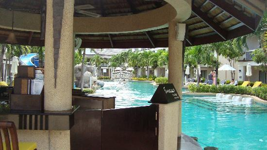 Centara Kata Resort Phuket: The pool area through the pool bar