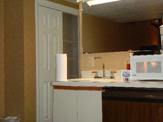 The Admiralty Inn: Fridge on the lower right, microwave, coffee maker and sink area.