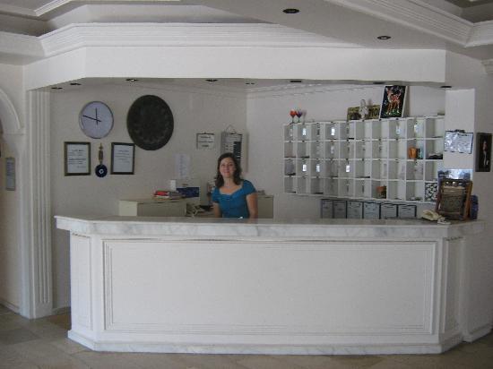 Olivia behind the Delta Hotel Reception desk
