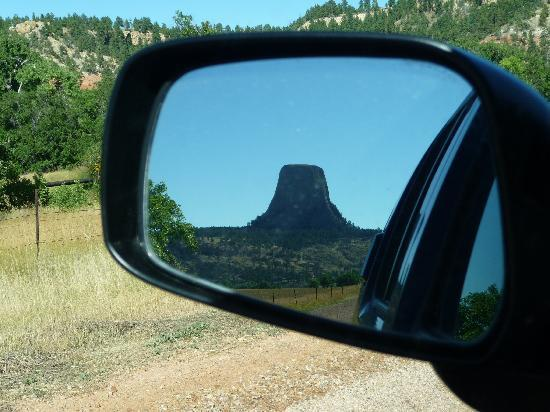 Lytle Creek Inn Bed and Breakfast: Devils tower behind us as we drive on the gravel road to the B&B.