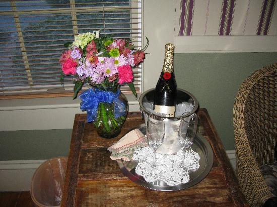 "Snug Cottage: Expensive ""Celebration"" flowers and champagne"