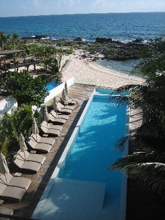 Hotel Secreto: View out the balcony of the infinity pool, deck, and beach