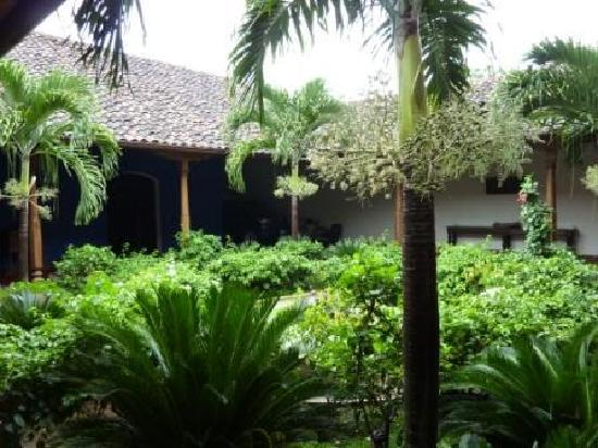 Miss Margrit's Guest House: Courtyard with my Hi-Lux rental tucked away in the back