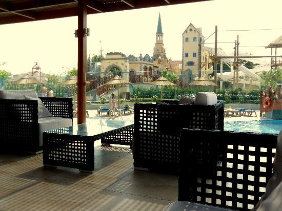 Holiday Village Rhodes: welcome shade on the terrace, overlooking hotels waterpark and high climbing ropes