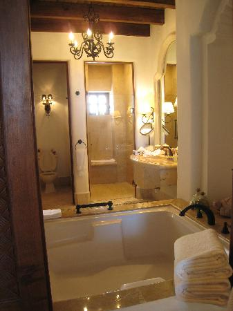 2-person jacuzzi and separate his and her vanity areas