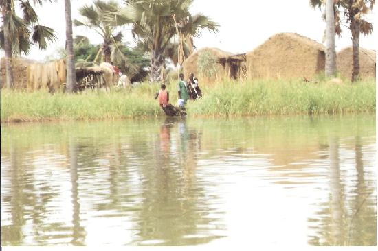 Mali: Children on a small boat near their village