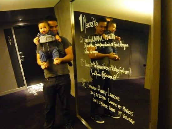 Mama Shelter Paris: On the lift landing, there is a mirror where they would update guests with the daily activities.