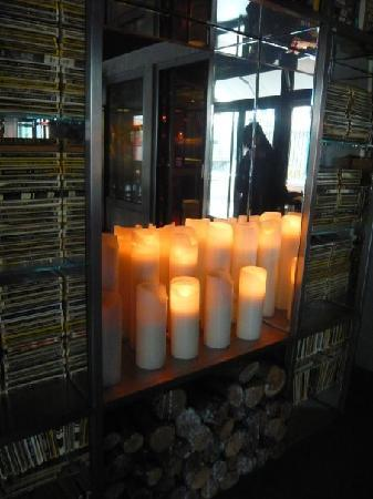 "Mama Shelter Paris: Creative use of chunky candles as ""fireplace""."