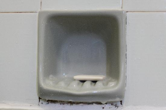 Crooklands Hotel: mildew around soap holder, discoloured grouting everywhere.