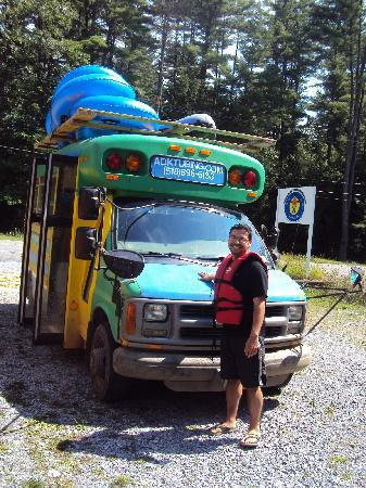 Adirondack Tubing Adventures : My bf next to our transportation for the day