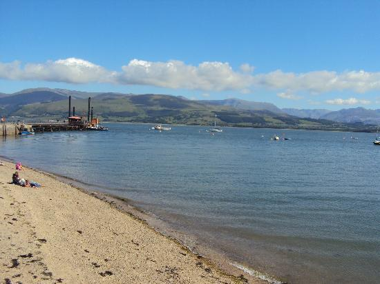 Beaumaris, UK: view across the Menai Straits to Snowdonia