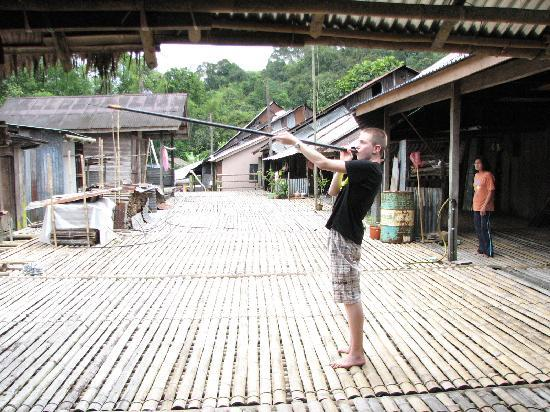 Annah Rais Longhouse Adventure: trying the blowpipes