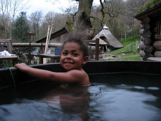 Cae Mabon: in the hot tub.  celtic round house behind