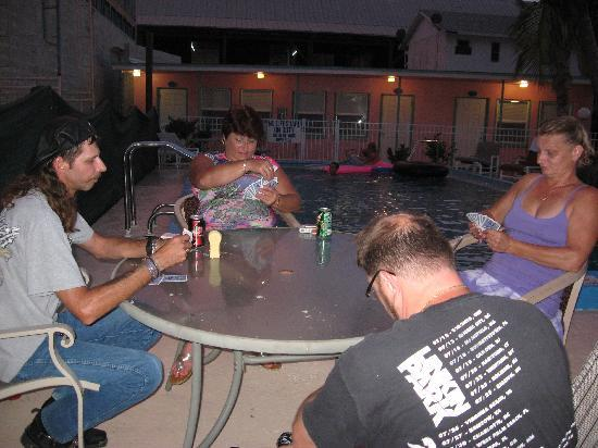 Shipwreck Motel: Poolside card game after an evening out