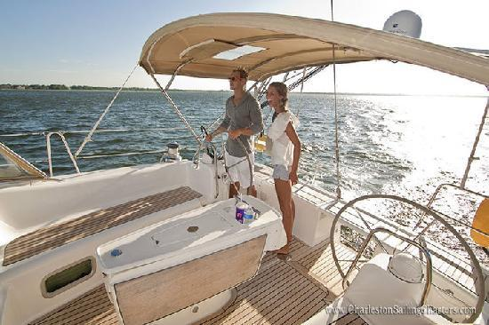 Charleston Sailing Charters: A couple enjoying a sail on the harbor