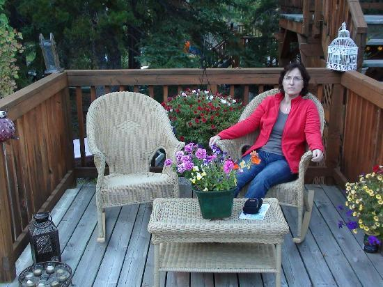 Off Our Rockies Bed and Breakfast: My wife relaxing in the backyard of the B&B