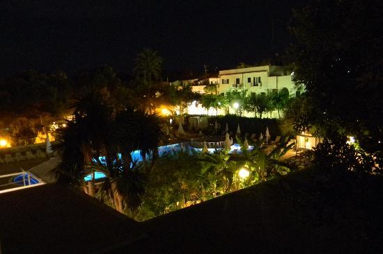 SENTIDO Tucan: The pool area at night from our balcony...