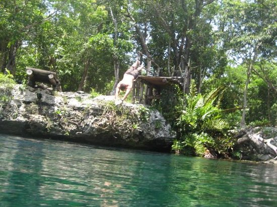 Cliff diving into Cenote with Edventure Tours