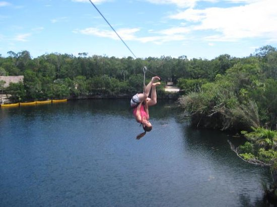 Sis crossing lagoon on a Zip line with Edventure Tours