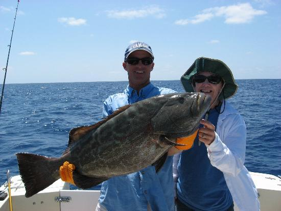 Her biggest grouper ever picture of seize the day for Key west florida fishing trips