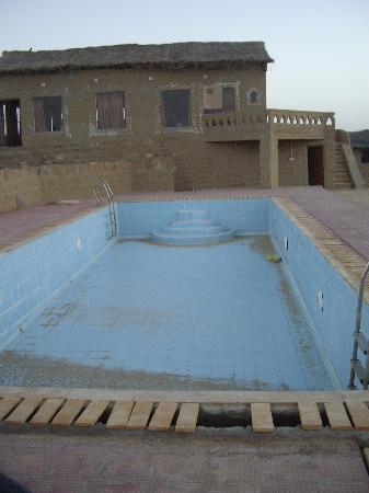 Empty Swimming Pool With The Closed Restaurant In The