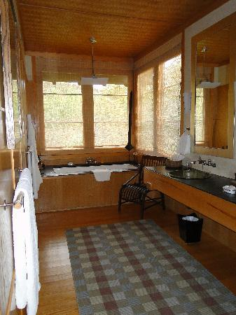 Twin Farms: sink and tub area in Orchard Cottage