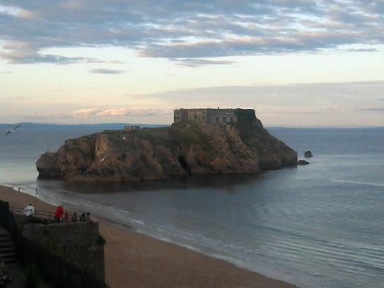 Tenby, UK: View at sundown of North Beach and old prison