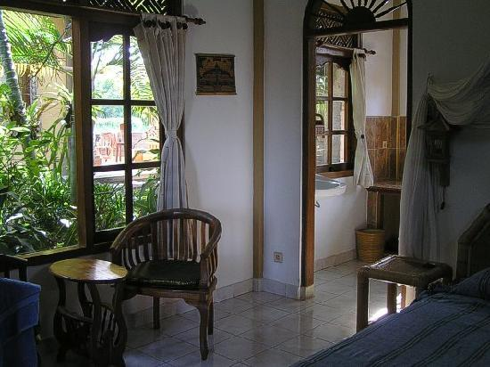 Hibiscus Cottages: part of the bedroom and little room that adjoins the bathroom