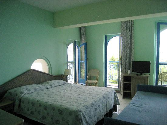 Villa San Michele: Our room with 3 balconies and a small window over the bed
