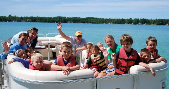 Elk Rapids, MI: Kids on pontoon boat ride