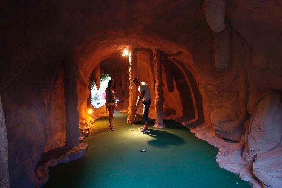 Golf Fantasía: a tropical parkland setting of caves, waterfalls and lakes, repleat with animal-life.